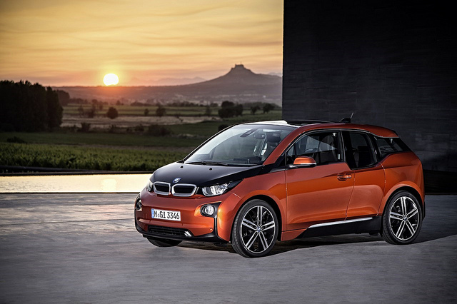 Sunset view and orange i3 BMW electric car