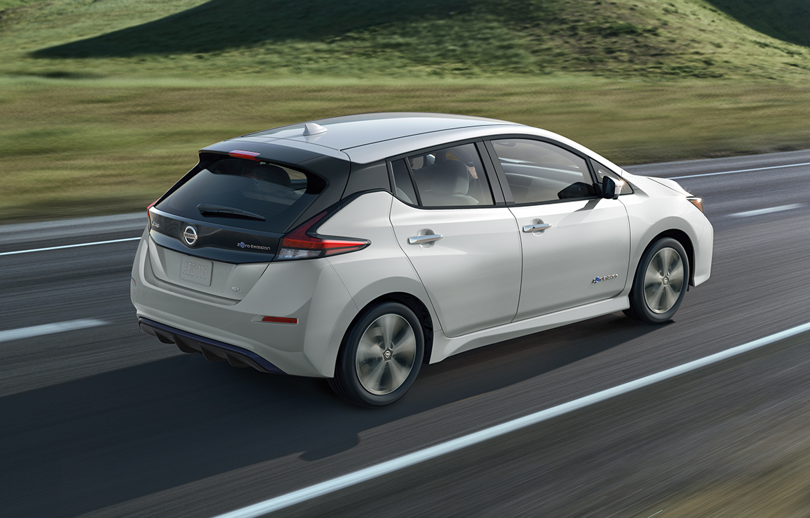 White Nissan Leaf Range running on a road